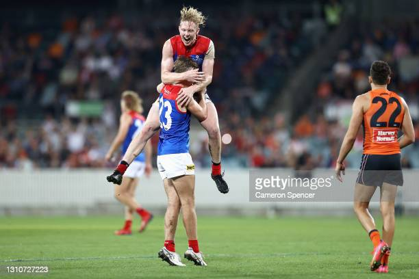 Clayton Oliver of the Demons congratulates James Jordon of the Demons after kicking a goal during the round 3 AFL match between the GWS Giants and...