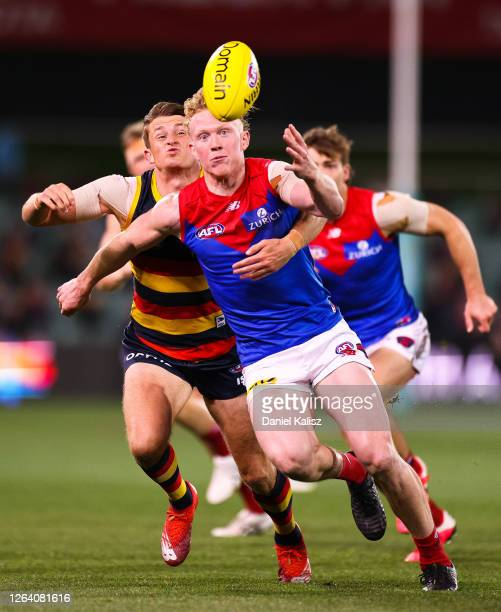 Clayton Oliver of the Demons is tackled by Matt Crouch of the Crows during the round 10 AFL match between the Adelaide Crows and the Melbourne Demons...