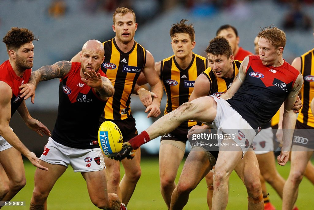 Clayton Oliver of the Demons kicks the ball during the round four AFL match between the Hawthorn Hawks and the Melbourne Demons at Melbourne Cricket Ground on April 15, 2018 in Melbourne, Australia.