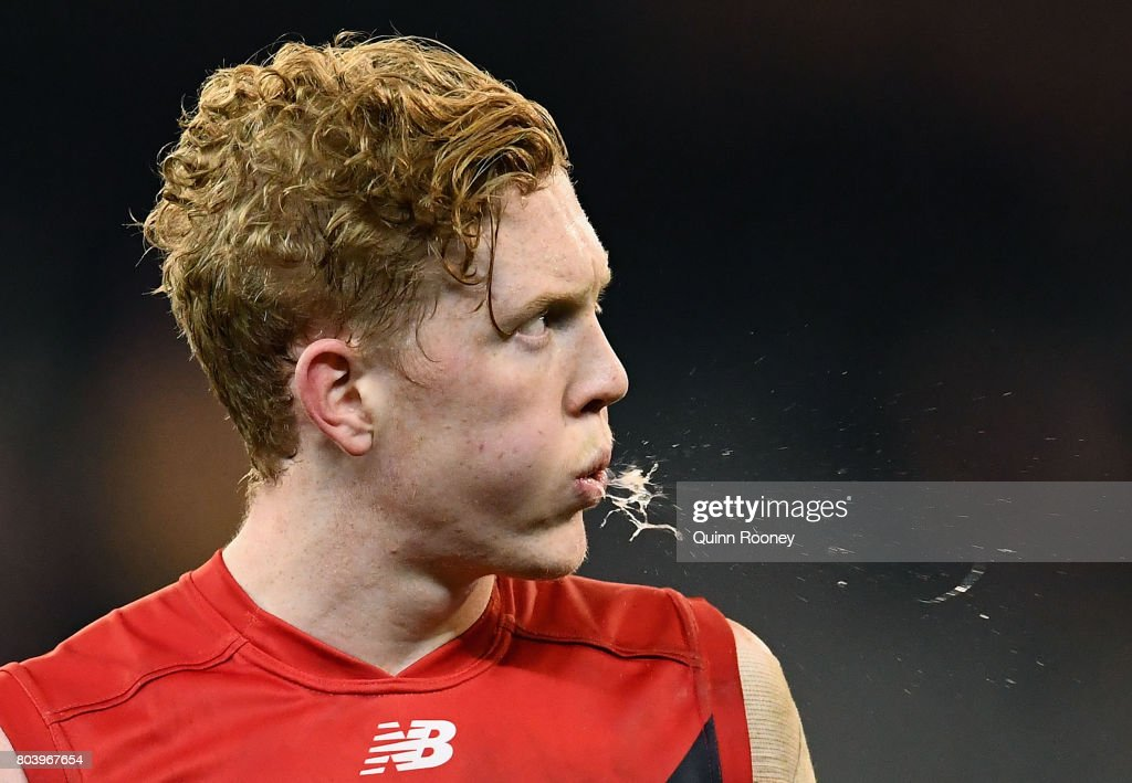 Clayton Oliver of the Demons looks dejected after losing the round 15 AFL match between the Melbourne Demons and the Sydney Swans at Melbourne Cricket Ground on June 30, 2017 in Melbourne, Australia.