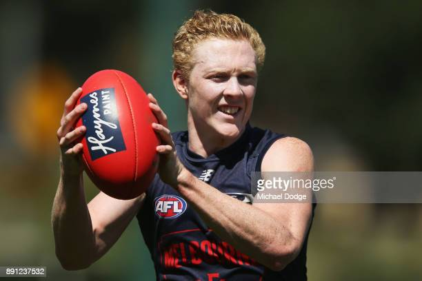 Clayton Oliver of the Demons looks fatigued upfield during a Melbourne Demons AFL training session at Gosch's Paddock on December 13 2017 in...