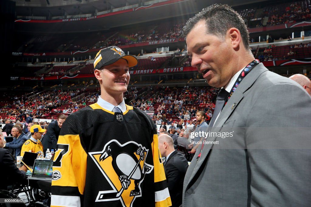 Clayton Phillips meets with assistant general manager Bill Guerin after being selected 93rd overall by the Pittsburgh Penguins during the 2017 NHL Draft at the United Center on June 24, 2017 in Chicago, Illinois.