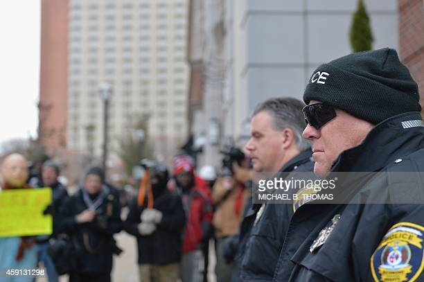 Clayton Police Deparment officers keep a watchful eye during a peaceful protest November 17 2014 streets in Clayton Missouri The governor of the US...
