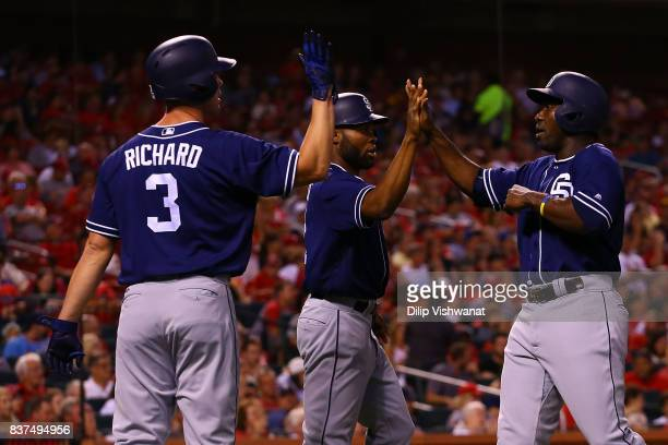 Clayton Richard Manuel Margot and Jose Pirela celebrate after scoring three runs against the St Louis Cardinals in the third inning at Busch Stadium...