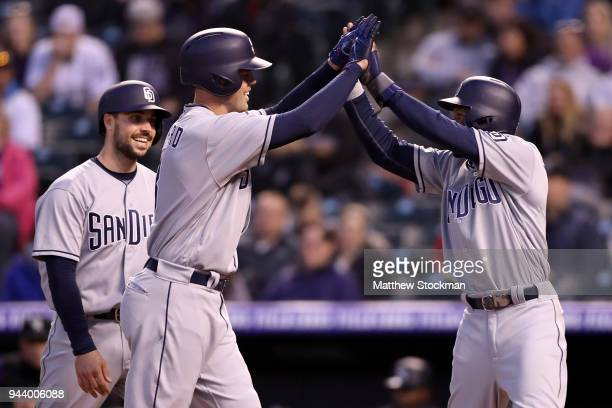 Clayton Richard of the San Diego Padres is congratulated at the plate by Austin Hedges and Manuel Margot after hitting a 3 RBI home run in the fourth...