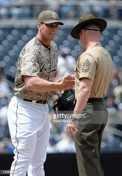 Clayton Richard of the San Diego Padres shakes hands with a Marine Corps drill sergeant before a baseball game against the Los Angeles Dodgers at...