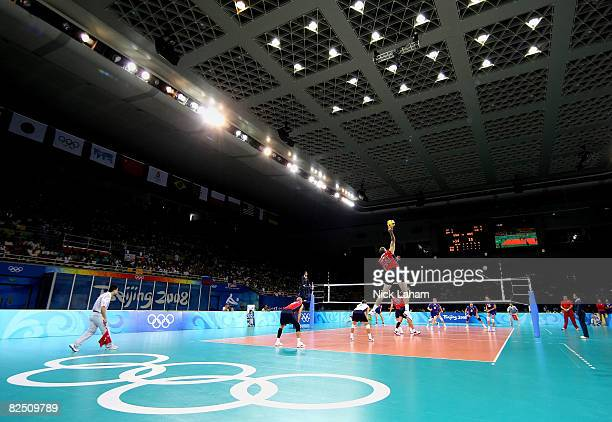 Clayton Stanley of the United States serves while taking on Russia during the semifinal volleyball game at the Capital Indoor Stadium on Day 14 of...
