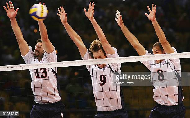 Clayton Stanley Ryan Millar and William Priddy of the Unted States jump for a block against Russia during the men's indoor Volleyball bronze medal...