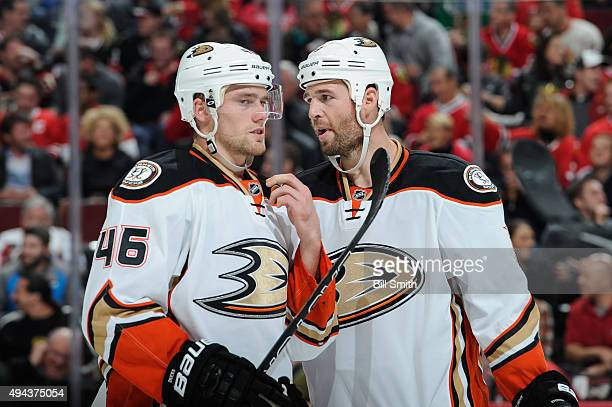 Clayton Stoner and Jiri Sekac of the Anaheim Ducks talk in the second period of the NHL game against the Chicago Blackhawks at the United Center on...