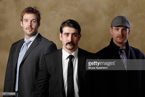 Clayton Stoner Cal Clutterbuck and Kyle Brodziak of the Minnesota Wild show off their moustaches for the Movember campaign for men's health awareness...