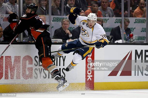 Clayton Stoner of the Anaheim Ducks and Viktor Arvidsson of the Nashville Predators leap to avoid a collision during the second period of Game Seven...