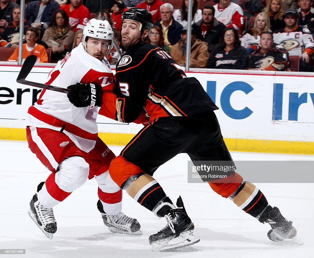 Clayton Stoner #3 of the Anaheim Ducks battles for position against Tomas Tatar #21 of the Detroit Red Wings on February 23, 2015 at Honda Center in Anaheim, California.
