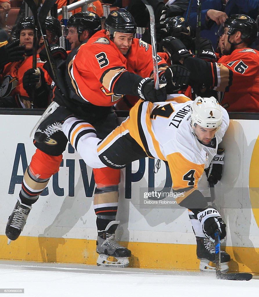 Clayton Stoner of the Anaheim Ducks checks Justin Schultz of the ... 3332c9077