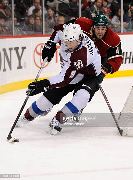 Clayton Stoner of the Minnesota Wild follows as Matt Duchene of the Colorado Avalanche brings the puck around the net in the first period on November...