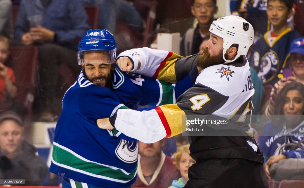 Clayton Stoner #4 of the Vegas Golden Knights lands a right hand during a fight with Darren Archibald #49 of the Vancouver Canucks in NHL pre-season action on September 17, 2017 at Rogers Arena in Vancouver, British Columbia, Canada.