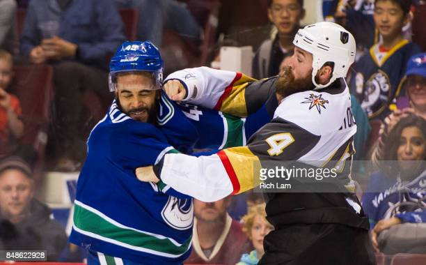 Clayton Stoner of the Vegas Golden Knights lands a right hand during a fight with Darren Archibald of the Vancouver Canucks in NHL preseason action...