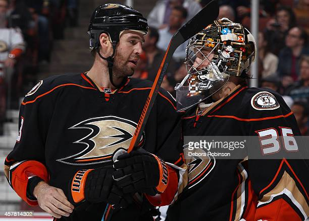Clayton Stoner talks with goaltender John Gibson of the Anaheim Ducks playing against the Columbus Blue Jackets on October 24 2014 at Honda Center in...