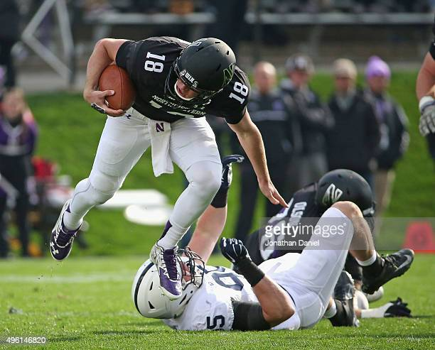 Clayton Thorson of the Northwestern Wildcats breaks away from Carl Nassib of the Penn State Nittany Lions at Ryan Field on November 7 2015 in...