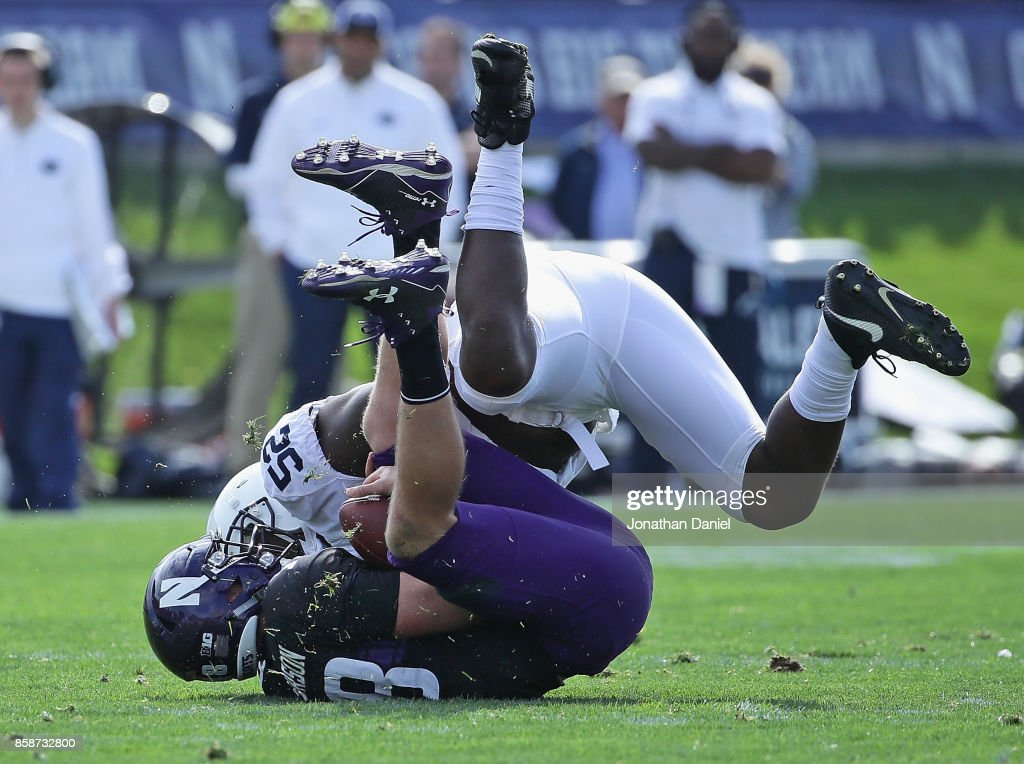Clayton Thorson #18 of the Northwestern Wildcats is sacked by Curtis Cothran #52 of the Penn State Nittany Lions at Ryan Field on October 7, 2017 in Evanston, Illinois. Penn State defeated Northwestern 31-7.