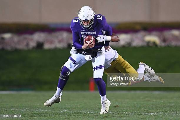 Clayton Thorson of the Northwestern Wildcats is sacked by Julian Okwara of the Notre Dame Fighting Irish during the second half of a game at Ryan...
