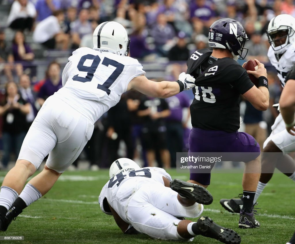 Clayton Thorson #18 of the Northwestern Wildcats is sacked by Ryan Buchholz #97 and Shareef Miller #48 of the Penn State Nittany Lions at Ryan Field on October 7, 2017 in Evanston, Illinois. Penn State defeated Northwestern 31-7.