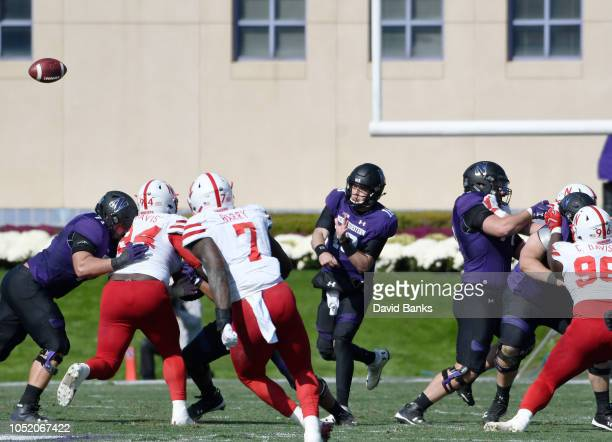 Clayton Thorson of the Northwestern Wildcats passes against the Nebraska Cornhuskers during the second half on October 13 2018 at Ryan Field in...