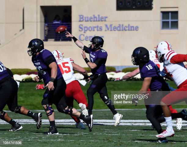 Clayton Thorson of the Northwestern Wildcats passes against the Nebraska Cornhuskers during the first half on October 13 2018 at Ryan Field in...