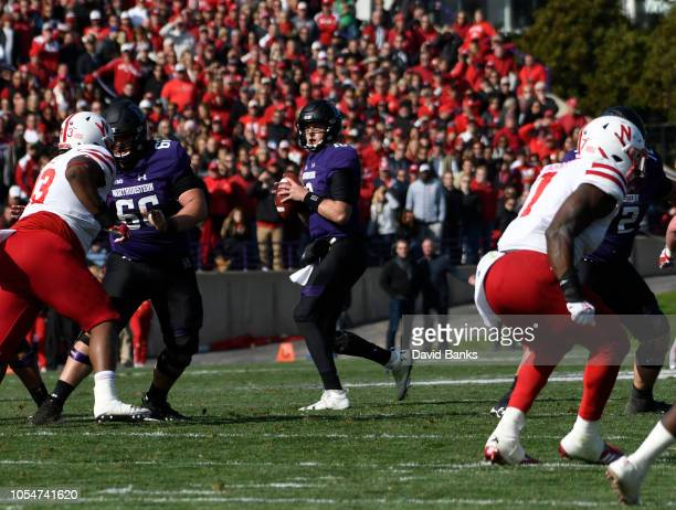 Clayton Thorson of the Northwestern Wildcats passes during the second half on October 13 2018 at Ryan Field in Evanston Illinois Northwestern won...