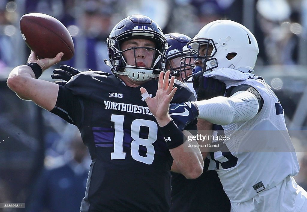 Clayton Thorson #18 of the Northwestern Wildcats passes under pressure from Shaka Toney #18 of the Penn State Nittany Lions at Ryan Field on October 7, 2017 in Evanston, Illinois.