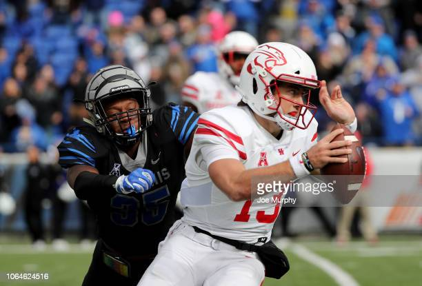 Clayton Tune of the Houston Cougars scrambles with the ball against Tim Hart of the Memphis Tigers during the 1st half on November 23, 2018 at...