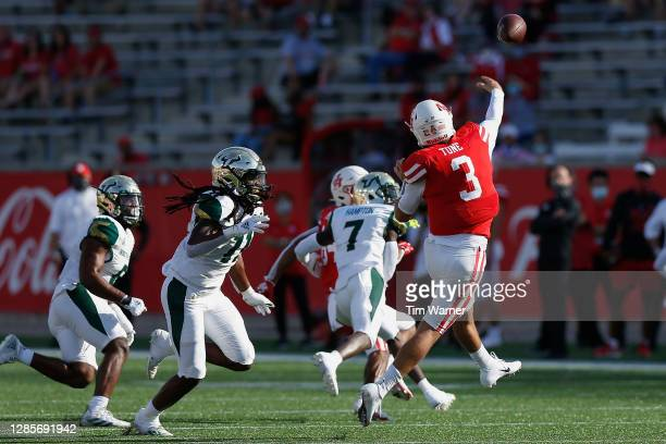 Clayton Tune of the Houston Cougars throws a pass under pressure by Dwayne Boyles of the South Florida Bulls in the first half on November 14, 2020...