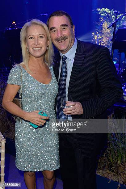 Clea Newman and Nigel Mansell attend the second annual SeriousFun Network Gala at at The Roundhouse on November 4 2014 in London England