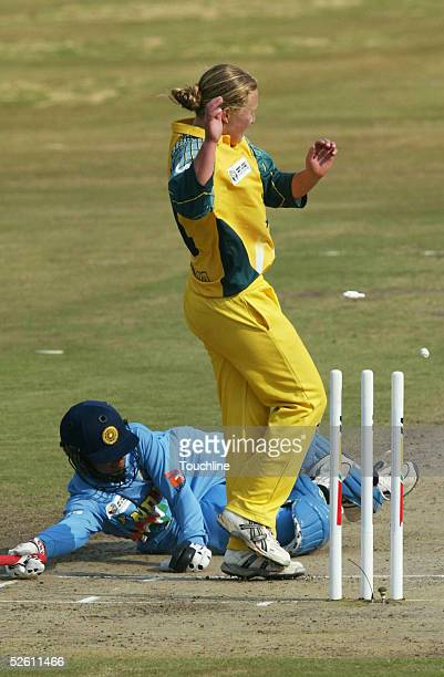 Clea Smith of Australia covers the stumps as Anjum Chopra of India is run out by a throw from Julie Hayes during the IWCC Women's World Cup Final...