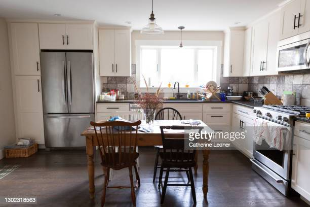 clean and charming remodeled country kitchen with light streaming through window. - catherine ledner stock pictures, royalty-free photos & images