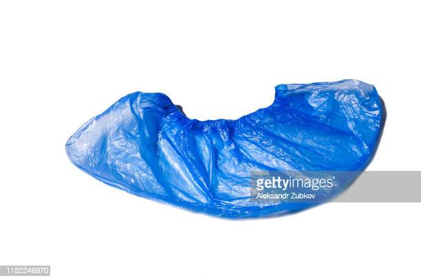 clean blue medical shoe cover, plastic protectors plastic shoe cover, isolated on white background. hygiene in medical institutions. single use, disposable. - shoe covers stock pictures, royalty-free photos & images