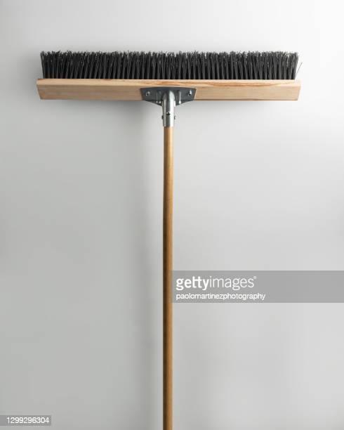 clean broom against white background - 掃く ストックフォトと画像