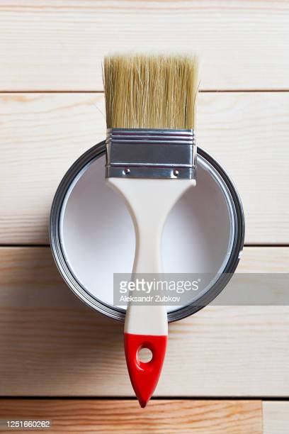a clean brush on a bank of white paint, on a wooden background. close up. construction and repair. - restoration style stock pictures, royalty-free photos & images