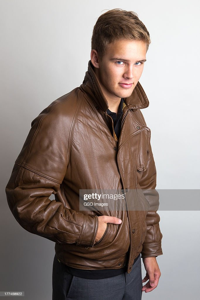 Clean cut teen youth in leather jacket : Stock Photo