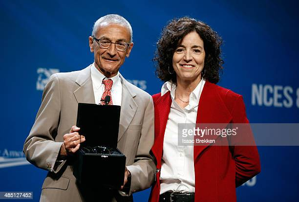 Clean Energy Project Chairwoman Kathleen Drakulich presents former counselor to President Barack Obama John Podesta with the Clean Energy Project...