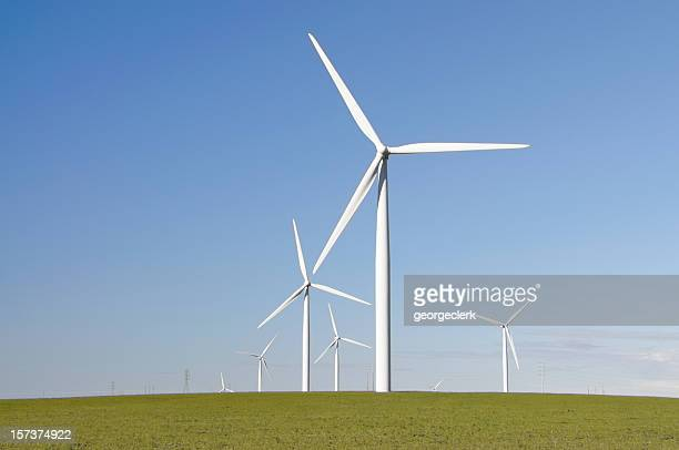 clean green wind energy - windmills stock photos and pictures