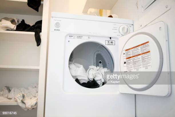 Clean laundry remains in the dryer in the apartment where Maj. Nadil Malik Hasan lived at the Casa Del Norte apartment complex November 12, 2009 in...
