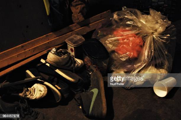 Clean needles used sharps and shoes lay next to a bag of trash to be collected at Homeless residents create a sense of normalcy and humanity in their...