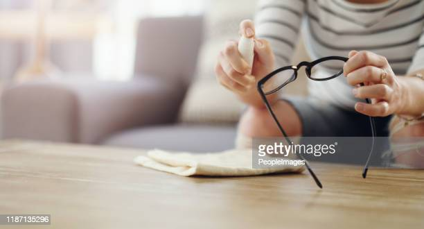 clean regularly for a clear vision - eyeglasses stock pictures, royalty-free photos & images