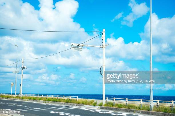 clean road and good weather in okinawa - road signal stock pictures, royalty-free photos & images