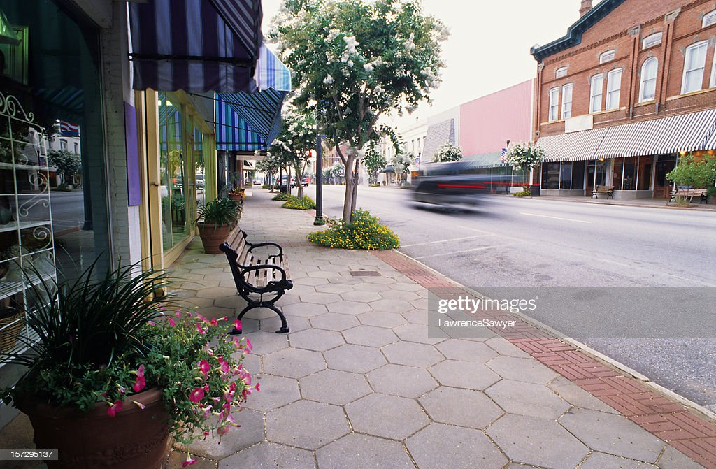 Clean road with bench in Americus, Georgia : Stock Photo