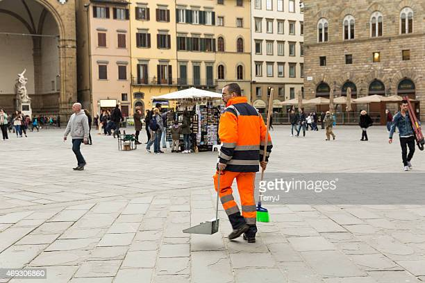 clean up worker looks for discarded items - street sweeper stock pictures, royalty-free photos & images