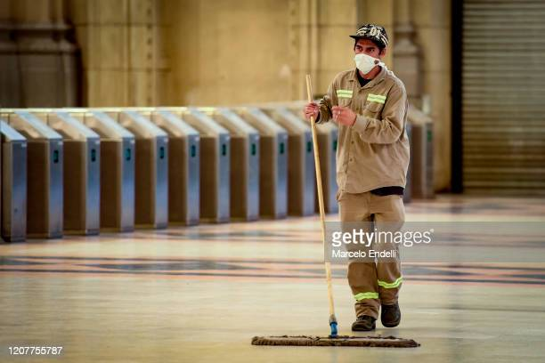 Clean up worker wearing protective mask works Constitucion Train Station on March 20, 2020 in Buenos Aires, Argentina. President Alberto Fernandez...