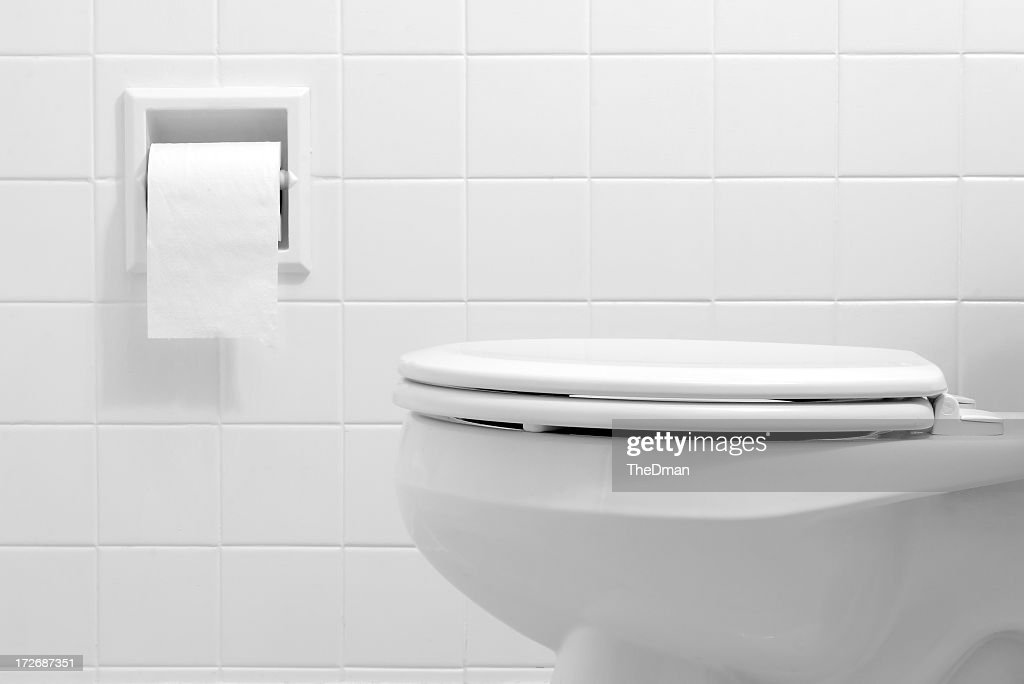 Clean, white bathroom toilet with the lid closed : Stock Photo