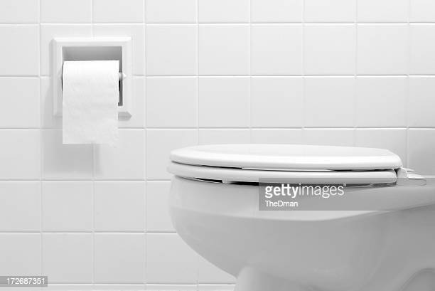 clean, white bathroom toilet with the lid closed - toilet stockfoto's en -beelden