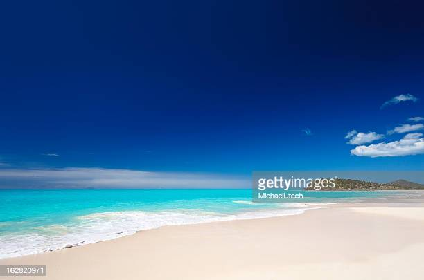 Clean White Caribbean Beach With Blue Sky